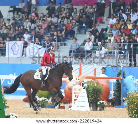 INCHEON - SEP 28:JUN Jaehee of Korea in action during the 2014 Incheon Asian Games at Dream Park Equestrian Venue on September 28, 2014 in Incheon, South Korea.