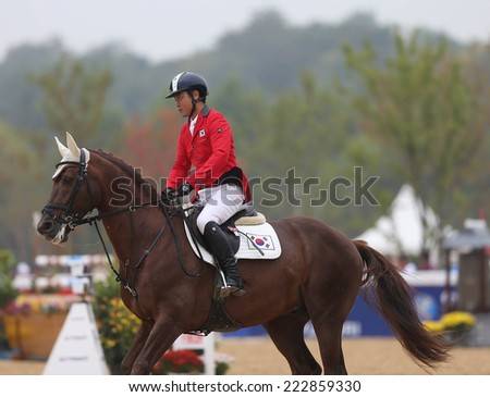 INCHEON - SEP 28:OH Sungwhan of Korea in action during the 2014 Incheon Asian Games at Dream Park Equestrian Venue on September 28, 2014 in Incheon, South Korea.