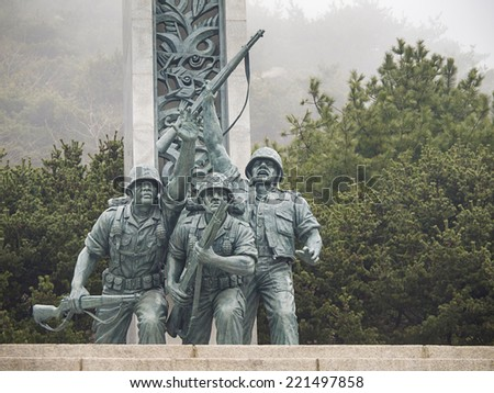 INCHEON, SOUTH KOREA-MAR 30: The statue of three soldiers in front of the statue of upholding liberty in Incheon Landing Operation Memorial Hall on Mar 30, 2012 in Incheon, South Korea. - stock photo