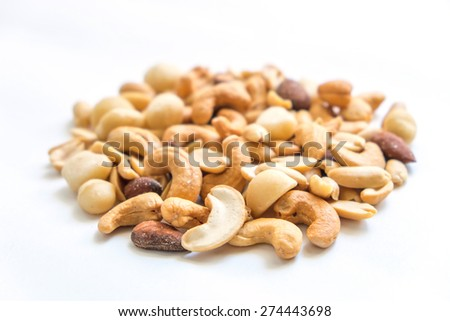 include nuts on with background , mixed nuts on with background - stock photo