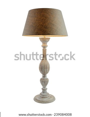 Included table lamp with shade on a wooden leg isolated on white