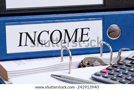 Income - blue binder in the office with calculator and pen - stock photo