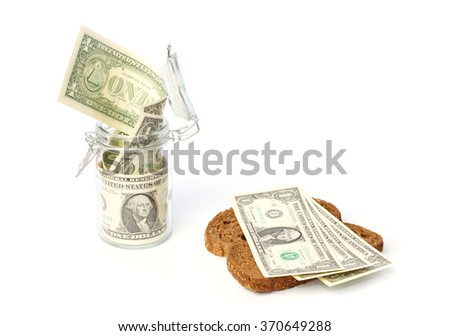 Income saving in a pot and spending on groceries - stock photo