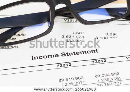 Income statement financial report with glasses; statement is mock-up