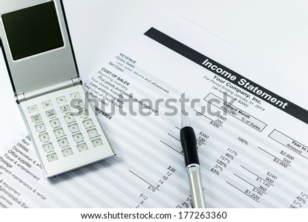 income statement report with calculator and pen for business - stock photo