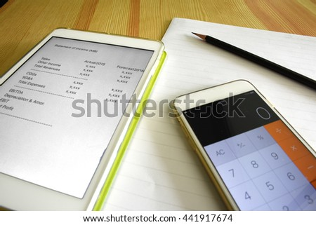 Income statement with paper for Business and Accounting Financial - stock photo
