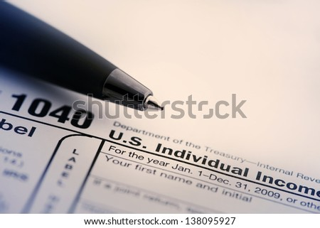 Income tax form and pen. Finance concept.