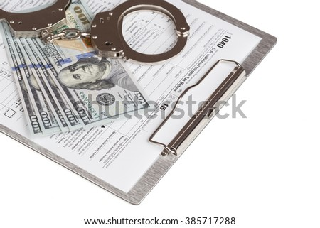 Income Tax Return Form with handcuffs and dollars
