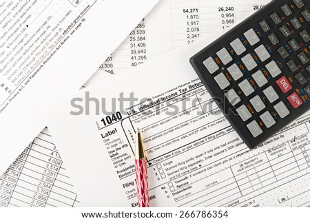 Tax calculator stock photos royalty free images vectors for Household bargaining and the design of couples income taxation