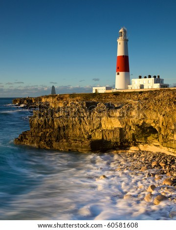 Incoming tide at Portland Bill lighthouse, Dorset, UK. Part of the UNESCO world heritage jurassic coast