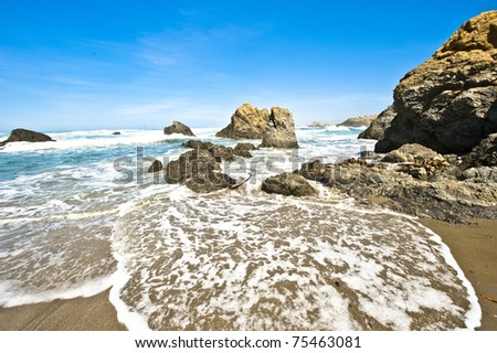 Incoming tide near Fort Bragg California. - stock photo