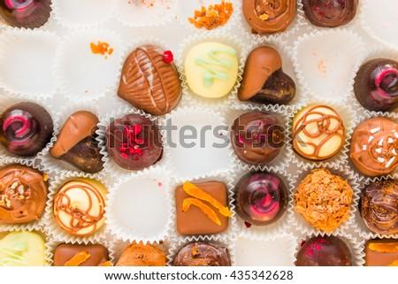 incomplete box of delicious handmade chocolates closeup - stock photo