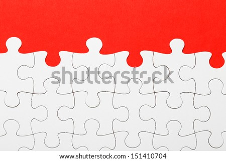 Incomplete puzzle in red color - stock photo