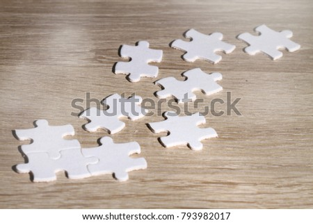 incomplete puzzle on a wooden table for a puzzle day
