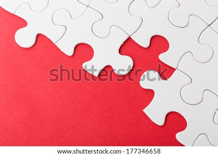 Incomplete puzzle over red background - stock photo