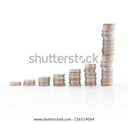 Increasing columns of coins on white background