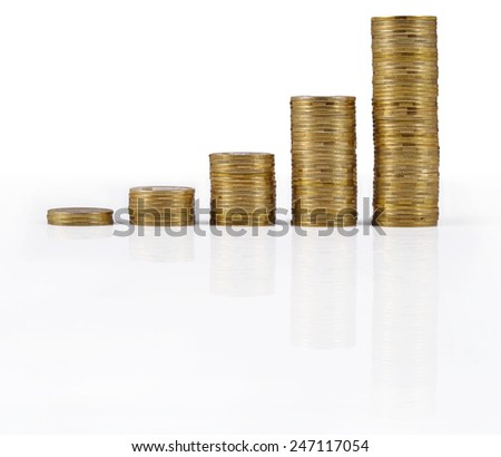 Increasingly higher stacks of gold coins on a white background - stock photo