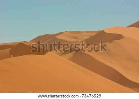 Incredible huge dunes of sand located in Sossusvlei in Namibia within the Namid desert - stock photo