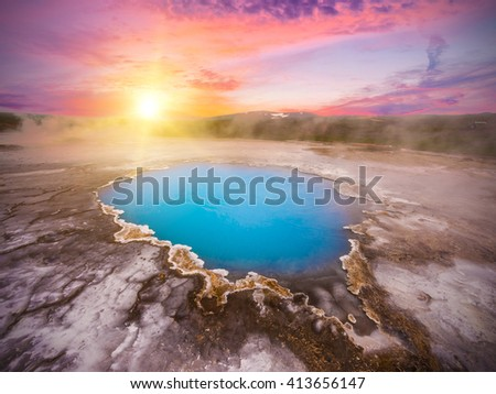 Incredibly blue pool Blahver at Hveravellir is actually a hot geothermal spring in the heart of Iceland. Photo taken around midnight sunset