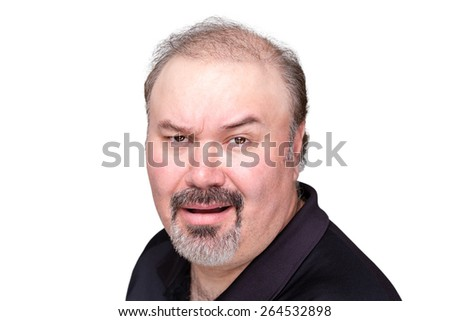 Incredulous man raising his eyebrow as he questions the veracity of something with a scoffing sneer, isolated on white