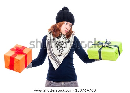 Indecisive woman looking at present, isolated on white background. - stock photo