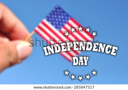 independence day usa banner on de focused flag in blue sky background