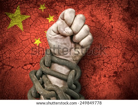 Independence: the hand, fist in chains and the flag of China - stock photo