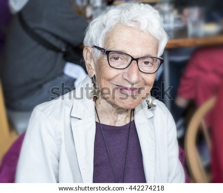 Independent Older Woman at Restaurant Smiling and Happy - stock photo