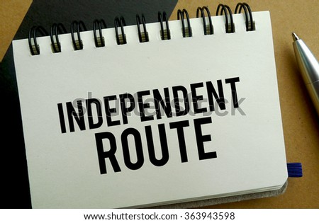 Independent route memo written on a notebook with pen
