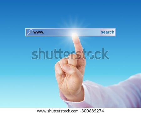 Index finger of a white collar worker is touching a void search tool bar of a browser. Do place your web address after the www in the blank finder bar. Copy space over turquoise background. Close up. - stock photo