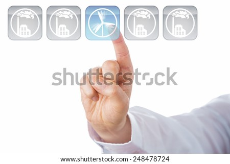 Index finger selecting a button with a wind turbine icon. Lighting up in blue, this key is in the center of a line-up of five. The other four grey icons show smoking factories. Cut out on white. - stock photo