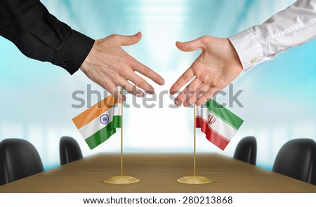 India and Iran diplomats agreeing on a deal - stock photo