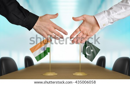 India and Pakistan diplomats shaking hands to agree deal, part 3D rendering - stock photo