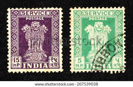 INDIA - CIRCA 1958: A pair of purple and green color postage stamp printed in India with image of India national emblem, the Ashokan lion. - stock photo