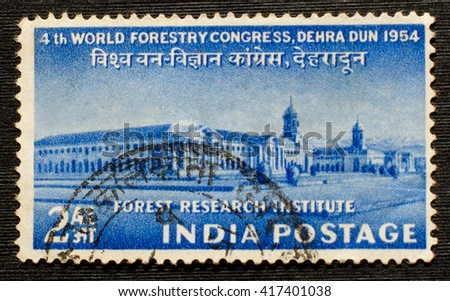 INDIA - CIRCA 1954: a postage stamp printed in India showing an image of the Forest research institut in honor 4th World Forestry ?ongress, circa 1954. - stock photo