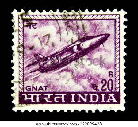 "INDIA - CIRCA 1967: A stamp printed in India shows a Gnat fighter jet from the Indian Air force, with the inscription ""Gnat"", from the series ""Definitive stamps"", circa 1967. - stock photo"