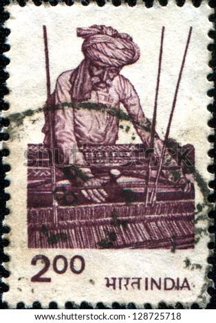 INDIA - CIRCA 1983: A stamp printed in India shows a man weaving, circa 1983 - stock photo