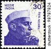 INDIA - CIRCA 1980: A stamp printed in India shows a portrait of the first Prime minister of India Jawaharlal Nehru, circa 1980. - stock photo