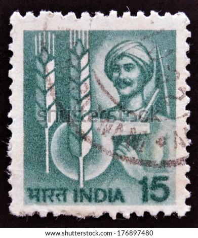 "INDIA - CIRCA 1979: A stamp printed in India shows Farmer and agricultural symbols from the series ""Crops and Farming"", circa 1979 - stock photo"