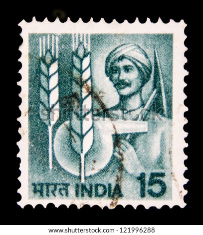 "INDIA - CIRCA 1979: A stamp printed in India shows Farmer and agricultural symbols, without inscription, from the series ""Crops and Farming"", circa 1979 - stock photo"