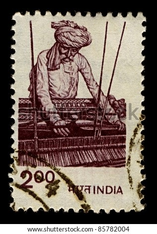 INDIA-CIRCA 1980:A stamp printed in India shows image of A loom is a device used to weave cloth, circa 1980. - stock photo