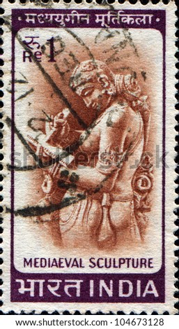 INDIA - CIRCA 1965: A stamp printed in India shows image of a medieval sculpture Woman writing a letter , circa 1965
