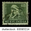 INDIA-CIRCA 1965:A stamp printed in INDIA shows image of tea pickers, circa 1965. - stock photo