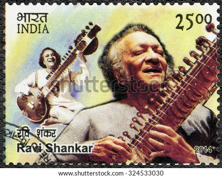 INDIA - CIRCA 2014: A stamp printed in India shows portrait of Ravi Shankar Robindro Shaunkor Chowdhury (1920-2012), circa 2014 - stock photo