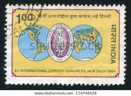 INDIA - CIRCA 1984: stamp printed by India, shows map of the globe and emblem, circa 1984 - stock photo