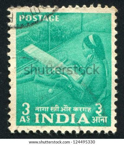 INDIA - CIRCA 1955: stamp printed by India, shows Naga woman at hand loom, circa 1955 - stock photo