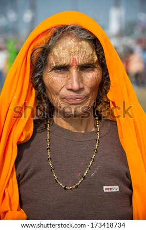 INDIA - FEBRUARY 17: Indian women in traditional dress after taking a holy bath in the Ganges River in Allahabad for Kumbh Mela Festival on February 17, 2013. - stock photo