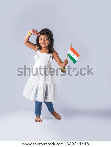 india flag and cute girl, 4 year indian girl standing and saluting indian flag or tricolour, india flag & girl, girl holding indian flag indian independence day, indian republic day, isolated - stock photo