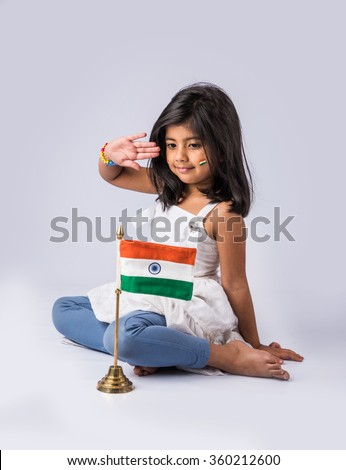 india flag and cute little indian girl, 4 year indian girl saluting indian flag or tricolour, india flag & girl, girl holding indian flag indian independence day, indian republic day, isolated - stock photo