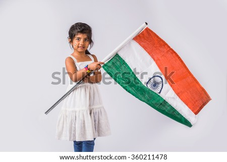 india flag and cute little indian girl, 4 year indian girl standing with indian flag or tricolour, india flag and girl, girl holding indian flag, indian independence day, indian republic day - stock photo